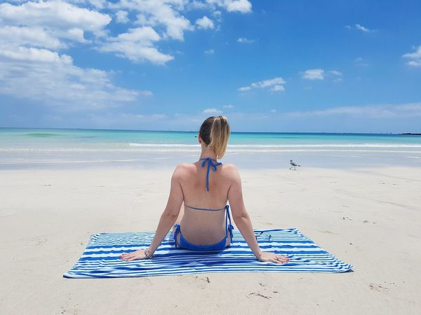 I'm in Miami beach Blue Sky Ocean EyeEm Gallery EymEm Nature Lovers Eyeem Market Woman Peace Peaceful Miami Miami Beach Blue Girl Enjoying Life Eym The Traveler - 2018 EyeEm Awards Water Sea Beach Sitting Blue Sand Summer Full Length Human Back Women Beach Towel Beach Holiday Bikini Back