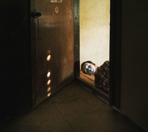 Man Wearing Mask At Doorway In Room