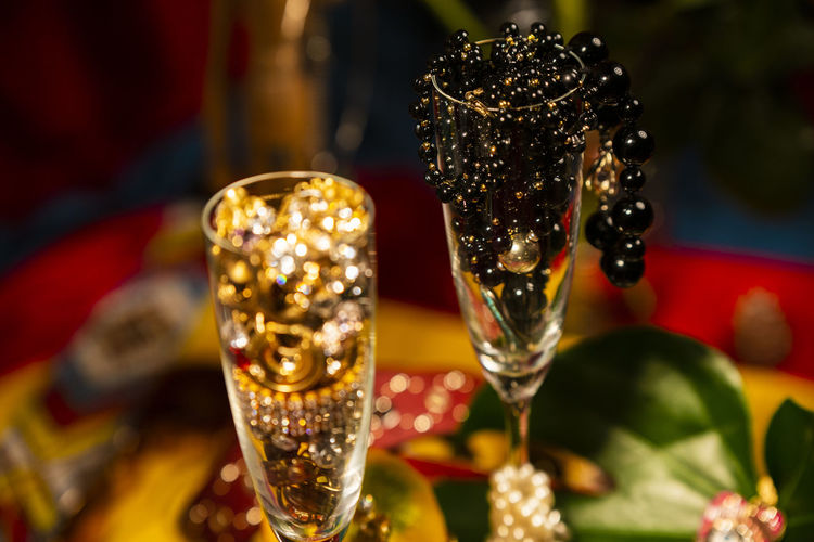 Celebrational Abundance Abundance Wealth Celebration Decoration Jewelry Pearls Glass Close-up Food And Drink Focus On Foreground Refreshment Selective Focus Drink Indoors  No People Alcohol Drinking Glass Household Equipment Food Red Shiny Luxury Freshness Business