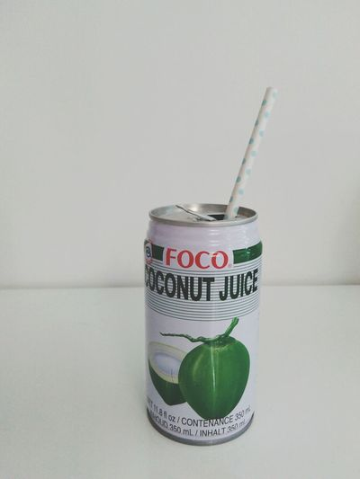 Green on white Coconut Juice Summertime Hot Days Fresh Drink