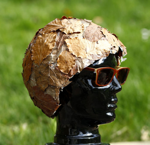 Artful Camouflage Close-up Contemporary Art Crazy Face Day Extraordinary  Extravagance Fashion Fashion Photography Focus On Foreground Hat Hat Fashion Headgear Helmet HelmetArt Model Nature No People Outdoors Outlandish Spectacle Fashion Statue Sunglasses Art Is Everywhere BYOPaper!