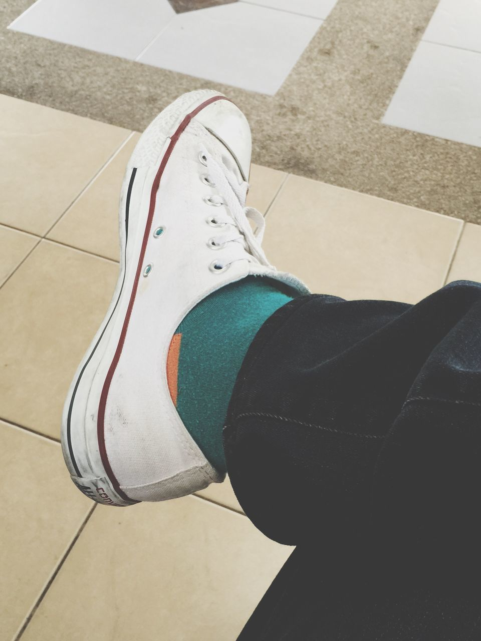 low section, human leg, shoe, real people, high angle view, one person, human body part, canvas shoe, personal perspective, indoors, leisure activity, lifestyles, day, sock, standing, close-up