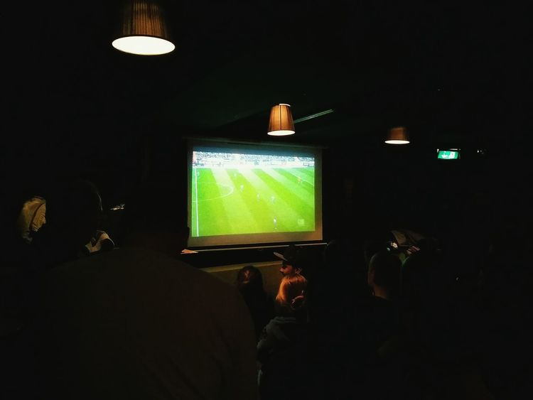 Watching Football. · Hamburg Germany Haus 73 Watching Football Real Football Sports People Together Darkness Sprinkles Of Light
