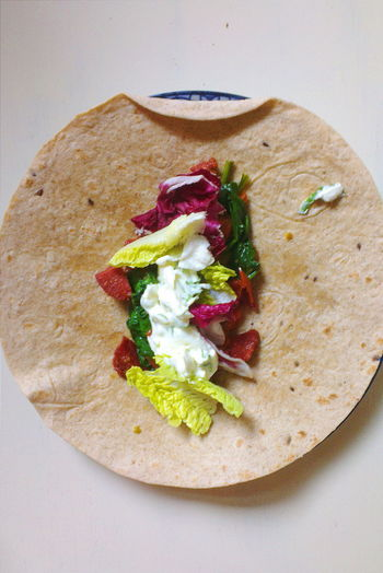 Directly above shot of salad on roti