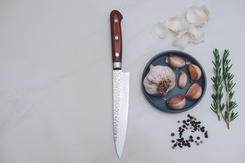 Garlic, Rosemary, Peppercorns and a Knife on white marble. Cooking Garlic Herb Herbs Knife PEPPERCORN Peppercorns Rosemary Day Directly Above Food Food And Drink Food Stories Freshness Garlic Garlic Bulb Garlic Clove High Angle View Indoors  Lay Flat No People Pepper Spice Spices White Marble