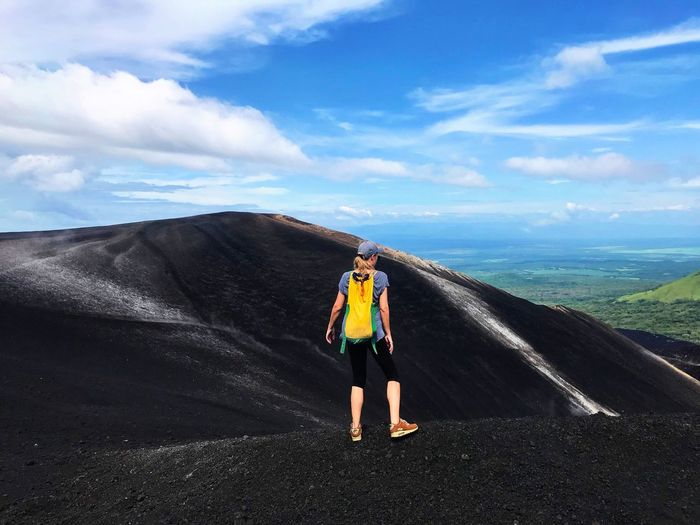 Nature Scenics Landscape Hiking Trail Extreme Sports Challenge Only Women Power In Nature Volcanic Landscape Lava Rocks Lava Field Adrenaline Junkie Volcanic Crater Determination Volcanic Rock Exploration Motion Nicaragua Cerro Negro Hiking Volcano Landscape Volcano Adventure Energetic Cloud - Sky