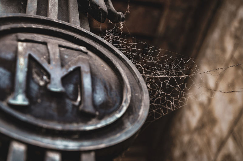 A day in the land of the dead Textures and Surfaces Abandoned Architecture Buenosaires Cementery Close-up Day Fence Focus On Foreground Fragility Machinery Metal Nature No People Old Outdoors Pattern Run-down Rusty Selective Focus Spider Web Tire Wheel
