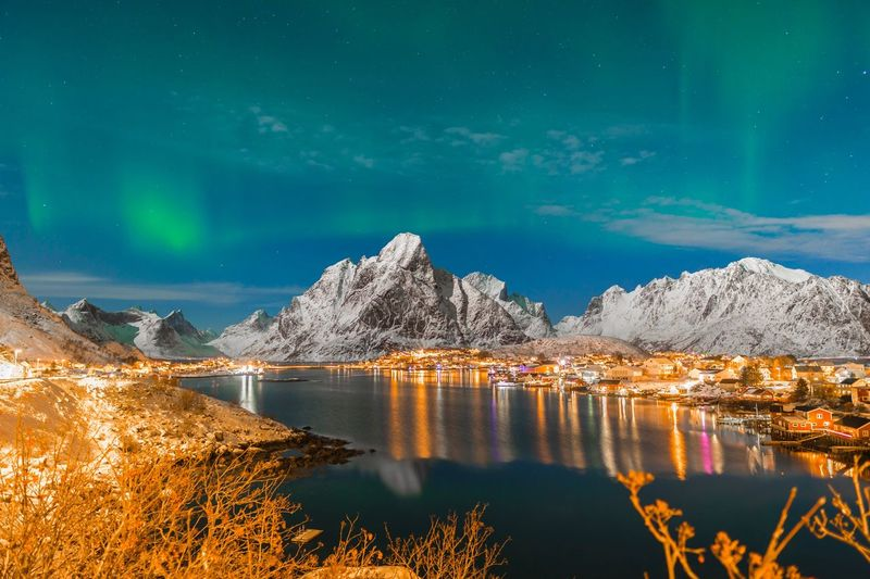 Aurora above Reine village Lofoten Norway Lofoten Islands Wall Textures WallpaperForMobile Wallpaper Background Texture Background Northern Norway Northern Lights Aurora Borealis Reflection Beauty In Nature Water Scenics Nature Lake Mountain Idyllic Tranquility Tranquil Scene Outdoors Cold Temperature Snow No People Waterfront Sky Winter Night Illuminated Iceberg