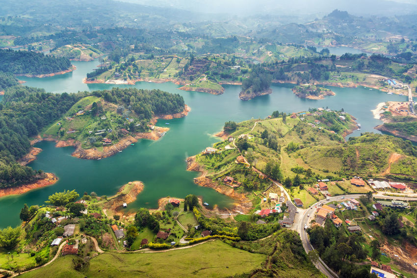 View of Guatape Lake from high above in Colombia Antioquia Beauty In Nature Blue Sky Building Cloudy Colombia Countryside Guatape High Islands Lake Landscape Lookout Medellín Natural Outdoors Picturesque Rock Scenics South America Tranquil Scene Travel Tree View Water