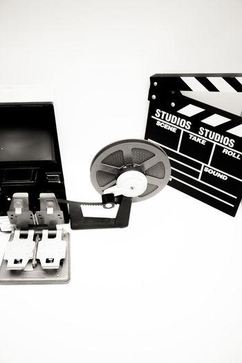 Editing desktop with super 8 film reels and movie symbols City Clapboard Clapper Clapperboard Desktop Editing Editing Machine Film Filmstrips MOVIE No People Reel Super 8 Symbol
