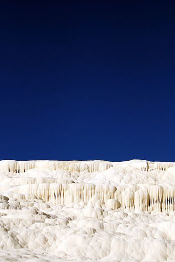 Scenic view of pamukkale against clear sky