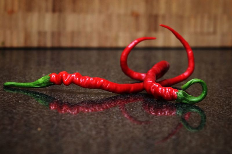 Close-up of red chili peppers on table