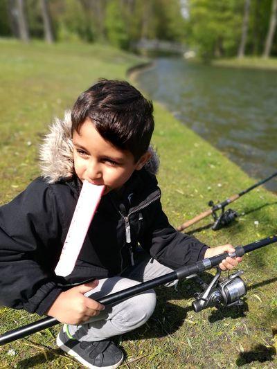 Ice Cream Fishing Kidsphotography Water Leisure Activity Children Only Childhood Child Grass The Portraitist - 2017 EyeEm Awards