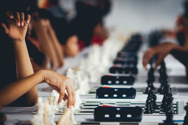 Close-up of hands playing chess