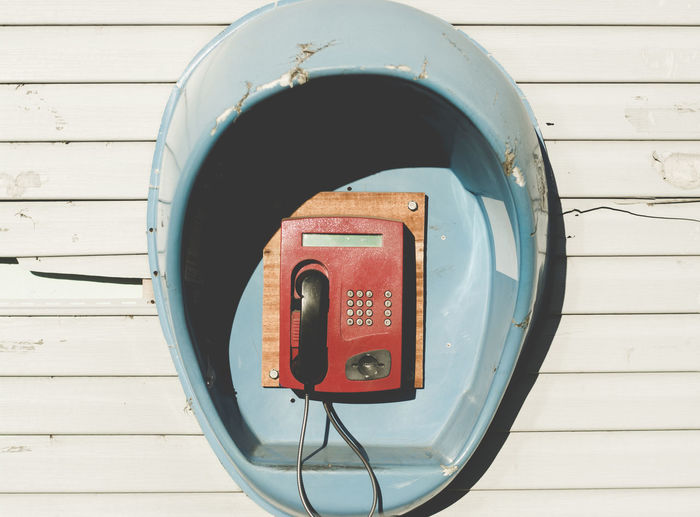 Close-up view of red telephone
