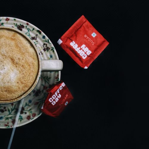 High angle view of coffee on table against black background