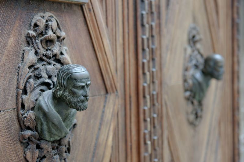 Human sculptures carved on wooden wall
