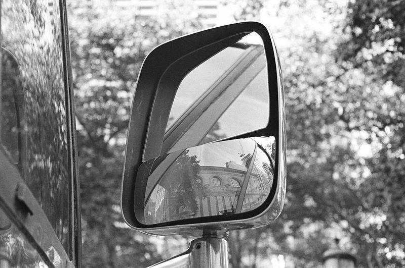 Airstream camper mirror, Bryant Park, Manhattan, August 2016 Transportation Close-up Mirror Land Vehicle Airstream Camper Airstream Camper Bryantpark Bryant Park  Bpfilmfest Canonet Canonetql17giii Kodak Tri-X 400 Kodak 35mm Film Film Photography Believeinfilm Focus On Foreground Mirror Reflection Side Mirror