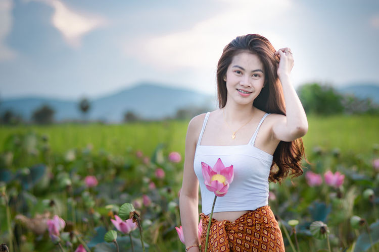 Young Adult One Person Beautiful Woman Young Women Front View Beauty Adult Flower Plant Women Standing Flowering Plant Hair Waist Up Nature Focus On Foreground Fashion Looking At Camera Clothing Hairstyle Outdoors