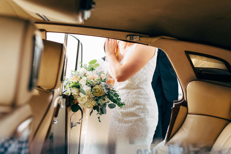 Flower Flowering Plant Plant Mode Of Transportation Transportation Motor Vehicle Land Vehicle Nature Flower Arrangement Bouquet Car One Person Adult Real People Sitting Indoors  Holding Vehicle Interior Wedding Freshness Flower Head