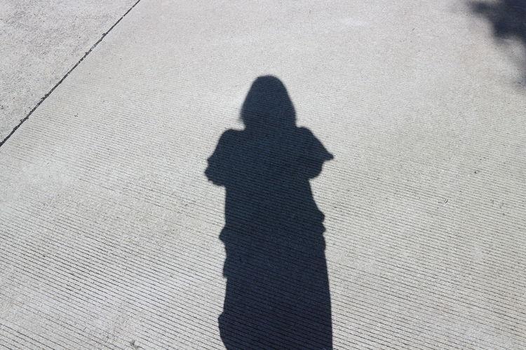 Shadow Of Woman On Street