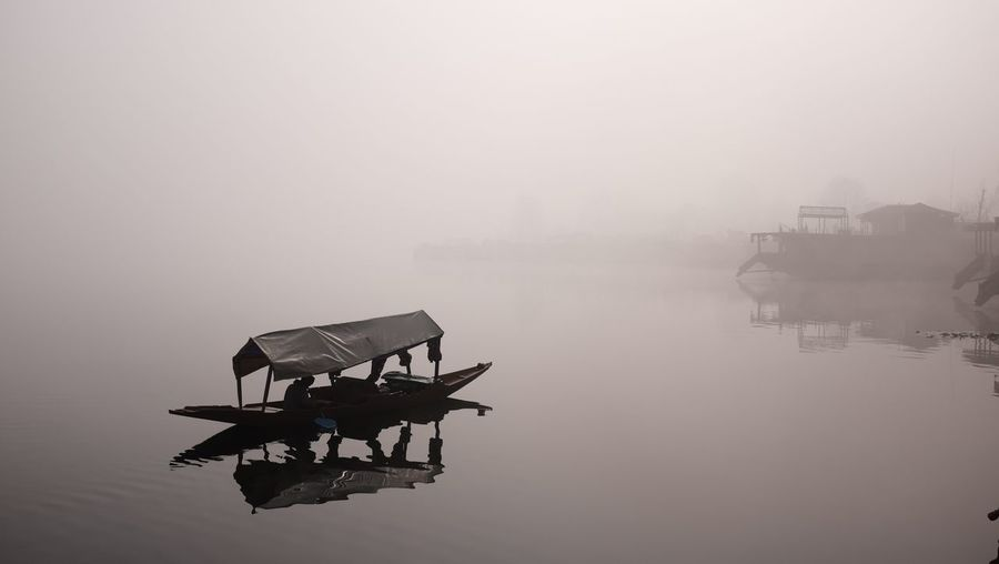 Scenic View Of Lake In Foggy Weather