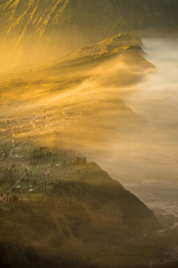 Golden hour in the morning at Bromo, Indonesia Beauty In Nature Environment Nature Sky Landscape Mountain Scenics - Nature No People Tranquility Tranquil Scene Cloud - Sky Sunset Architecture Outdoors Building Exterior Non-urban Scene Orange Color Building Built Structure High Angle View Golden Hour