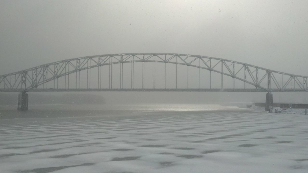 bridge - man made structure, connection, weather, engineering, fog, built structure, architecture, water, transportation, foggy, river, winter, cold temperature, no people, nature, outdoors, suspension bridge, day, travel destinations, sky