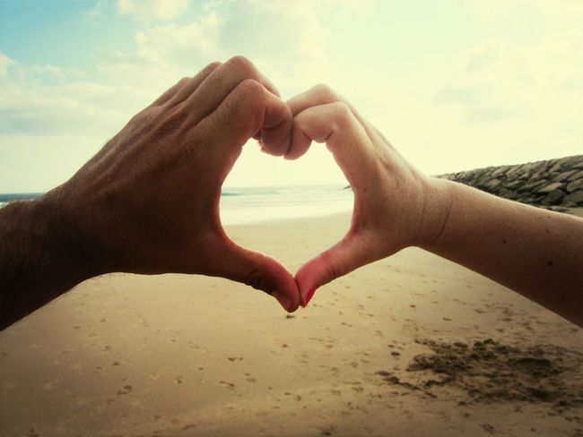 Love Hands on the beach.. Me And My Wife❤ My Wife And I Hands On Hands Hands Beach Photography Week On Eyeem Fresh On Eyeem  Summers Day Eyeemphoto Seascape Vacations Sea Summer Heart Shape Heart Hands Live For The Story Close-up
