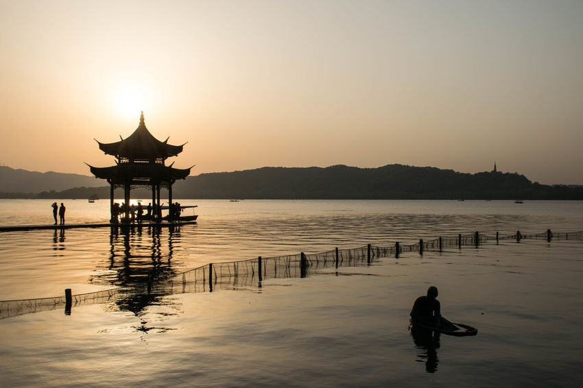 Hanging out in China Connected By Travel Beauty In Nature Lake Reflection Scenics Silhouette Sunset Tranquil Scene Tranquility Water Be. Ready. Be. Ready.