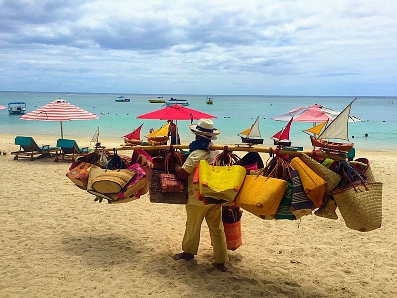 Selling handbags on the beach Outdoors Multi Colored Horizon Over Water Beach Sea Water EyeEmNewHere Travel Bags Handbags Seller Day