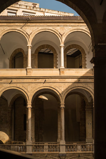 Courtyard of Palazzo Normanni, Palermo Arch Architecture Articulated Space Building Exterior Built Structure History Italy Light And Shadow No People Normandie Normanii Palermo, Italy Rounded Arch Rounded Window Sunlit Beauty Sunlit Glow Symetry Travel Destinations