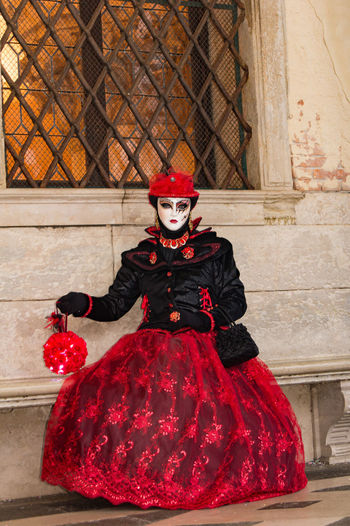 Carnival in Venice Carnival In Venice Adult Costume Day Front View Looking At Camera Mask - Disguise One Person One Woman Only Only Women Outdoors People Portrait Red Sitting Spooky Women Wool The Portraitist - 2018 EyeEm Awards