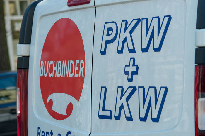 Logo of the Buchbinder Rent-a-Car company on the front of a white truck Delivery Van Rental Car Rental Van Lkw No People Pkw Rent A Car Rental Sign Text Transportation Truck Van Western Script