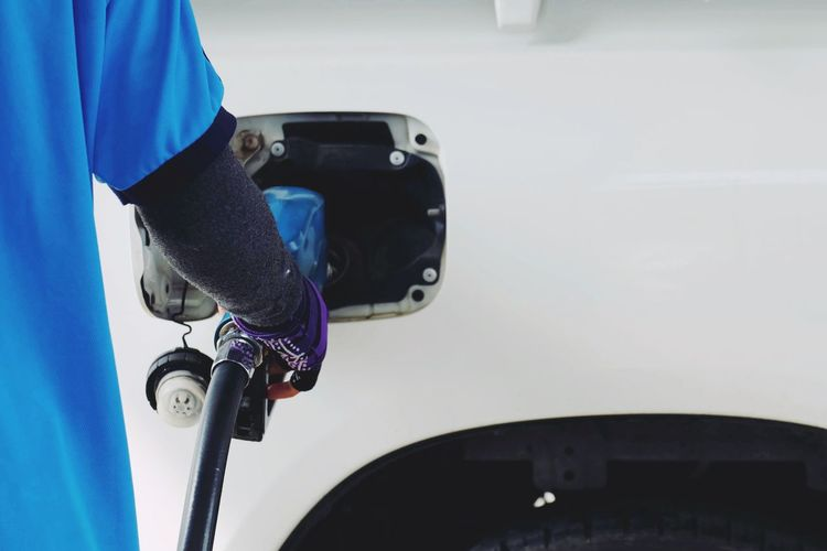 Worker hand holding nozzle fuel fill oil into car tank Work Pollution Power Energy Tank Petroleum Petrol Gas Station Vehicle Drive Industry Service Transportation Diesel Transport Gasoline Gas Pump Oil Business Environment Travel Technology Fuel Car