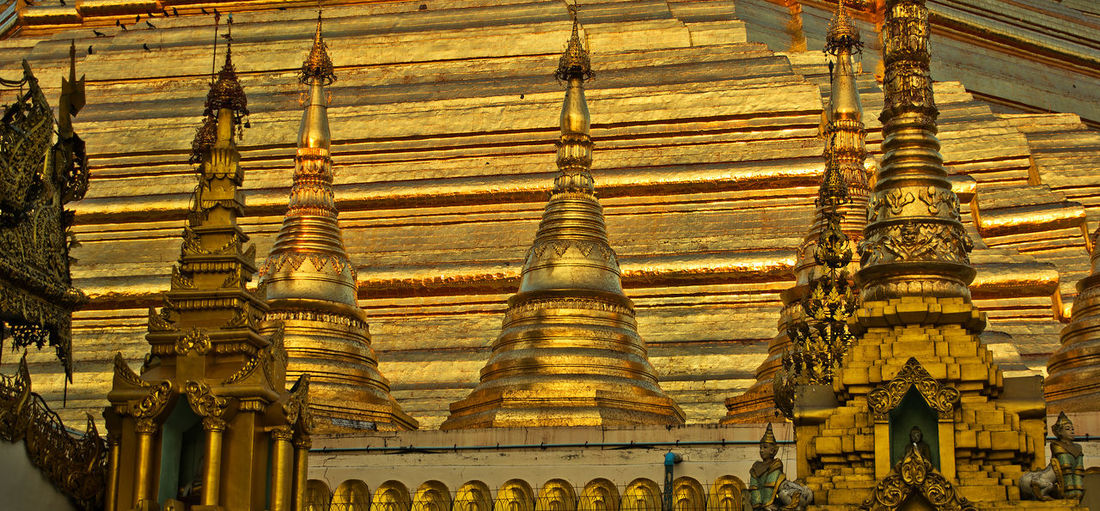Shwedagon Pagoda Stupas Tourist Attraction  World Heritage Yangon, Myanmar Architectural Column Architectural Design Architecture Buddhism Buddhist Temple Built Structure Burma Gold Colored History Place Of Worship Religion Spirituality Travel Destinations