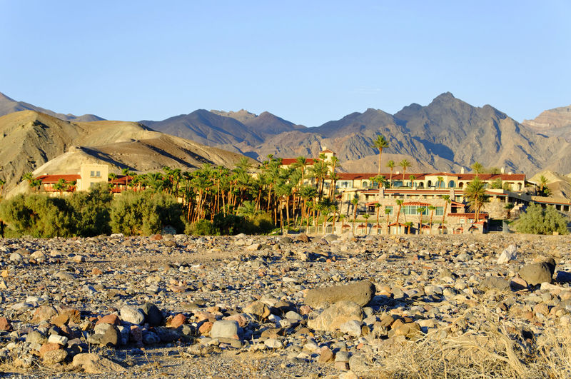Scenic view of houses and mountains against clear sky
