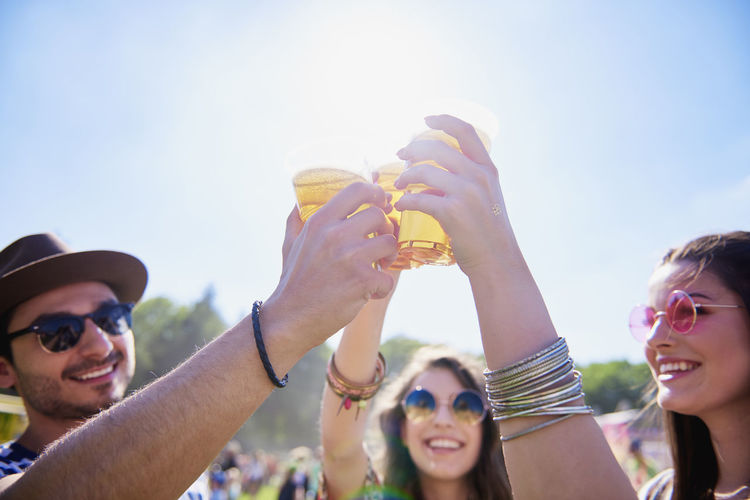 Friend Toast Beer Cool Beer Cool Beverage Cheers Three People Fun Party Sky Sunlight Hand Raised Festival Summer Alcohol Music Festival Drinking Good Times