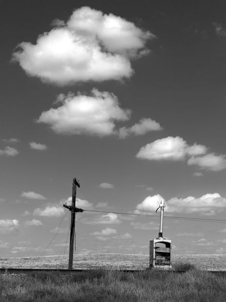 Blasted Black And White Cloud Cloud - Sky Dramatic Sky Journey Lonely No People Outdoors Prairie Prairie Scenes Railroad Railroad Track Sky Telegraph Telegraph Pole Travel