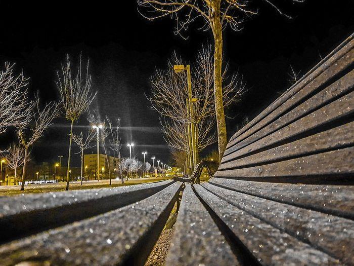 Close-up of illuminated railroad tracks during winter