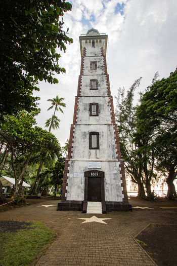 lighthouse in tahiti French Polynesia Lighthouse Travel Architecture Building Building Exterior Built Structure Cloud - Sky Day Growth Location Low Angle View Nature No People Outdoors Pacific Ocean Plant Sky Tower Tree Tropical The Architect - 2018 EyeEm Awards