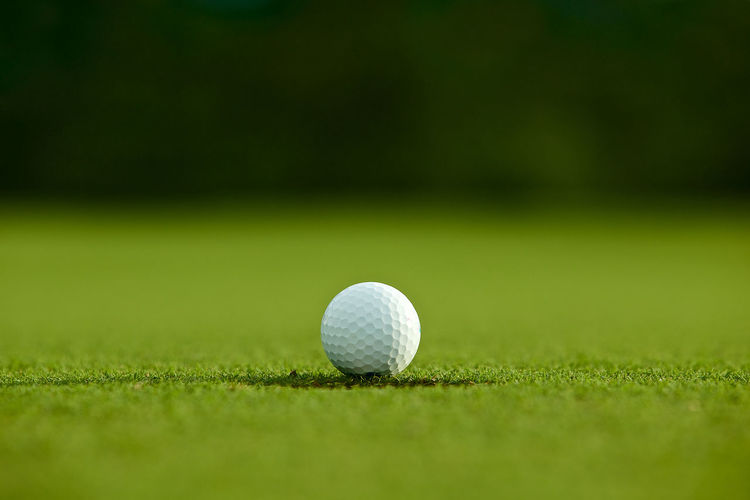 Close-up of golf ball on playing field