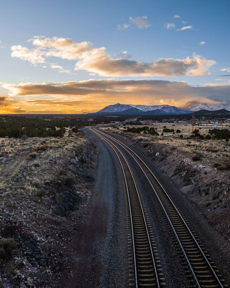 View of railroad tracks against sky during sunset