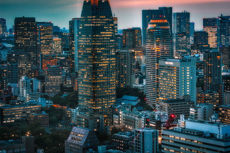 High angle view of illuminated buildings in city against sky in tokyo
