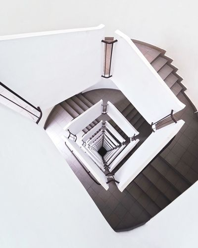 We spiral down 🌀 VSCO Allwhite Architectural Detail Architectural Feature Architecture_collection Architectural Column Warsaw Eyemphotography EyEmNewHere Spiral Spiral Staircase Architecture Low Angle View Built Structure No People Indoors