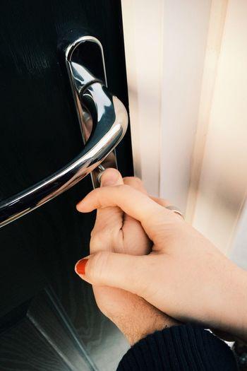Hands of couple opening front door with key