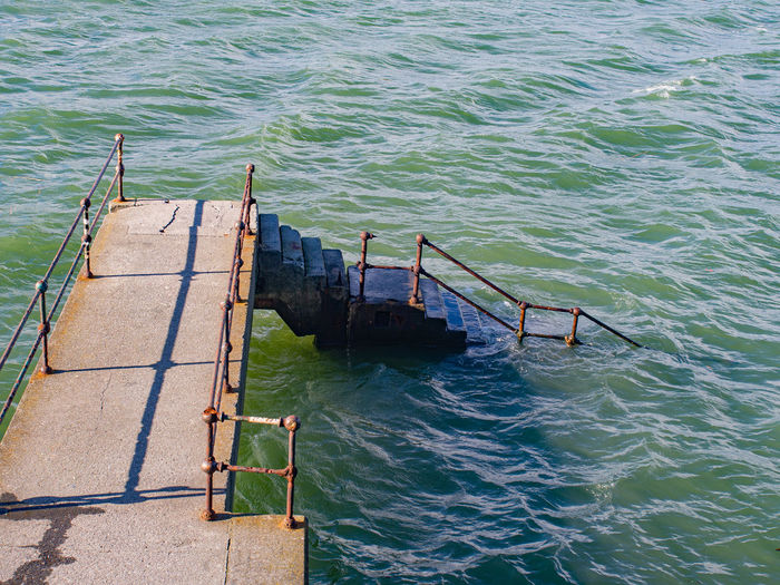 High angle view of abandoned pier over sea