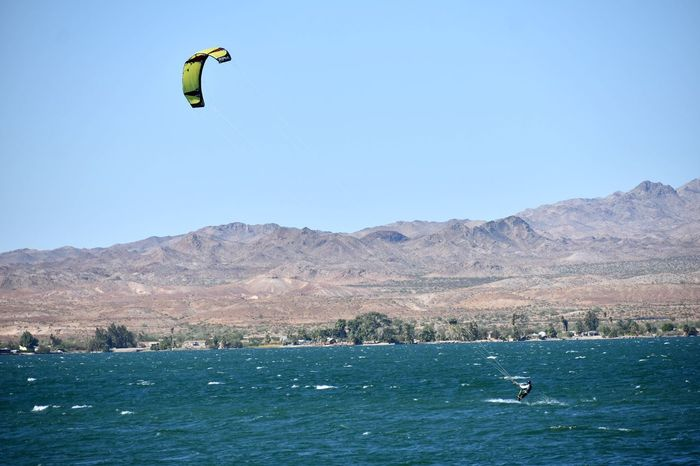Mid-air Flying Kiteboarding Jumping Nature Sport Extreme Sports Paragliding Outdoors One Person Water Motion Blue People Sea Sky Mountain Stunt Person Day Stunt