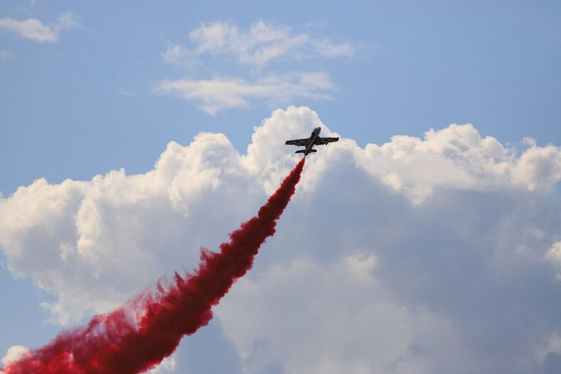 EyeEm Selects Cloud - Sky Air Vehicle Airplane Sky Mode Of Transportation Flying Low Angle View on the move Smoke - Physical Structure Day Speed Airshow Transportation Motion Fighter Plane No People Nature Plane Teamwork Military Airplane