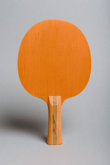 Close-up of orange table against white background